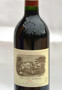 SH Enchères, Sophie Himbaut commissaire-priseur Vente online de vins et alcools provenant d'une importante cave particulière chateau-lafite-rothschild-2002-pauillac